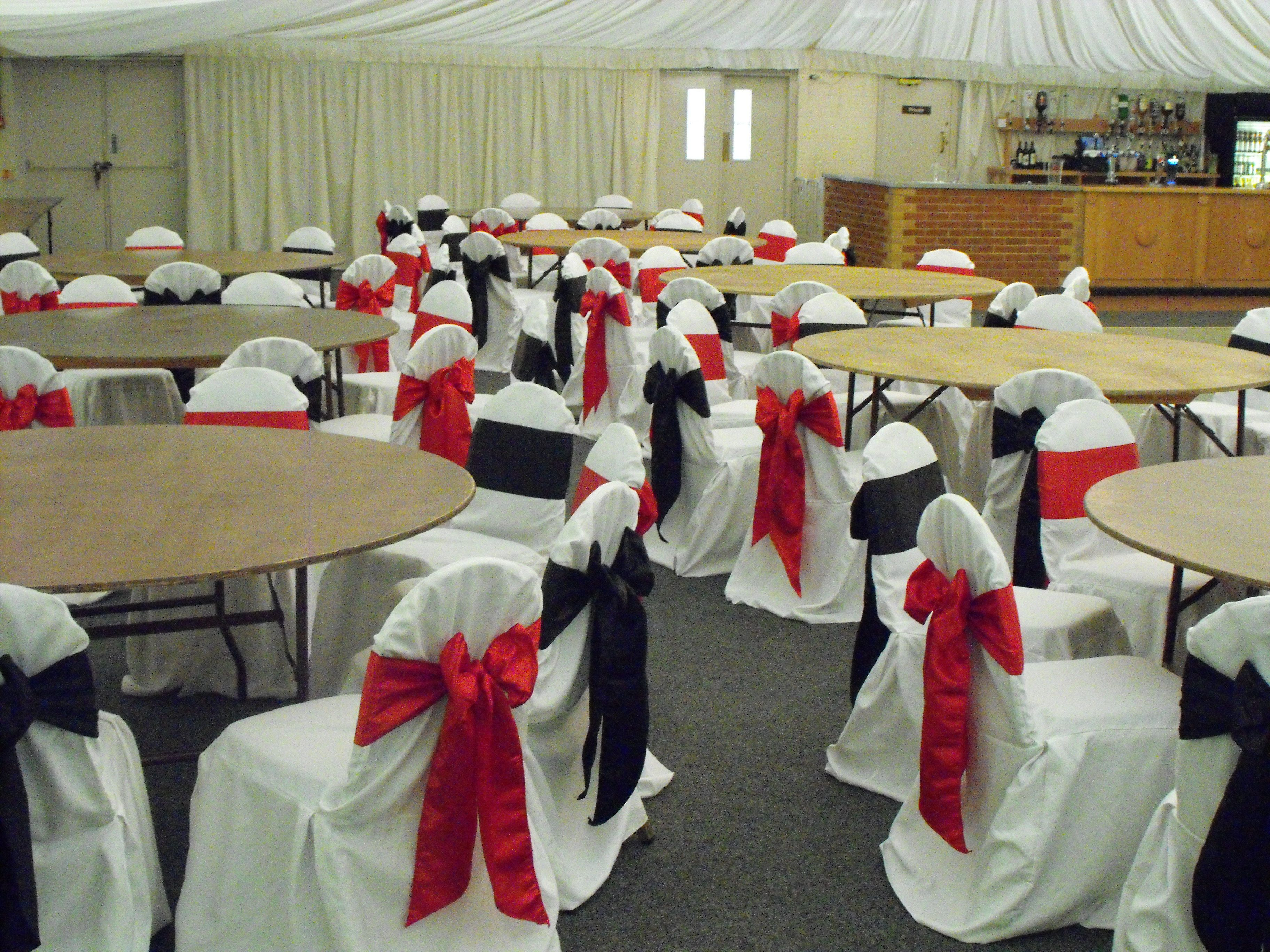 Alternating Black And Red Satin Bows On White Chair Covers Black