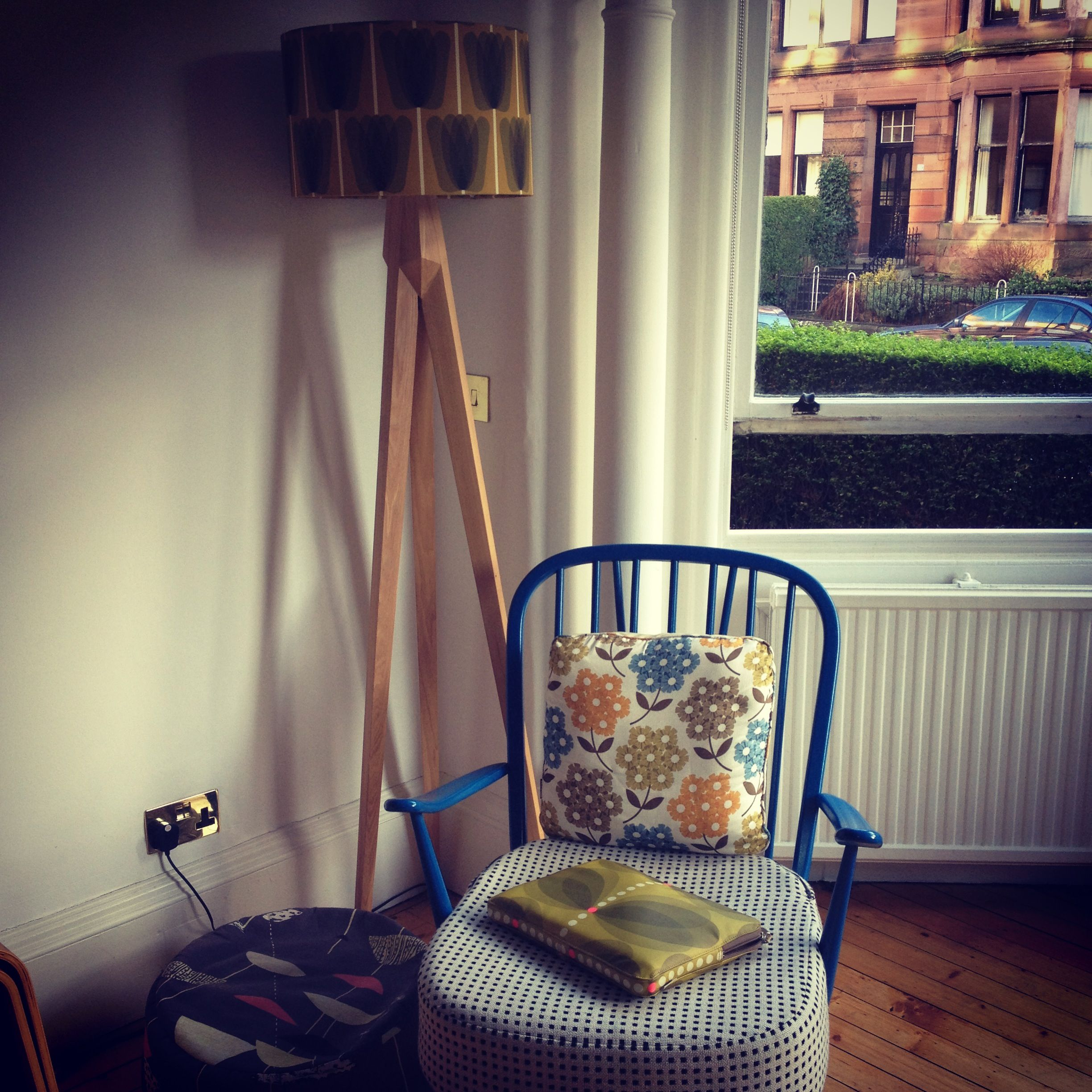 Ercol chair with Orla Kiely cushion and lampshade Habitat oak light