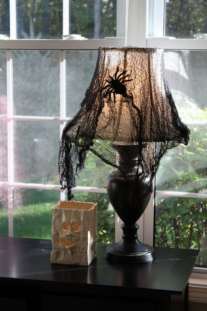 Love this idea...and I remember seeing the perfect 5 dollar lamp at Family Dollar - has a black shade but should work with grey or white cheesecloth