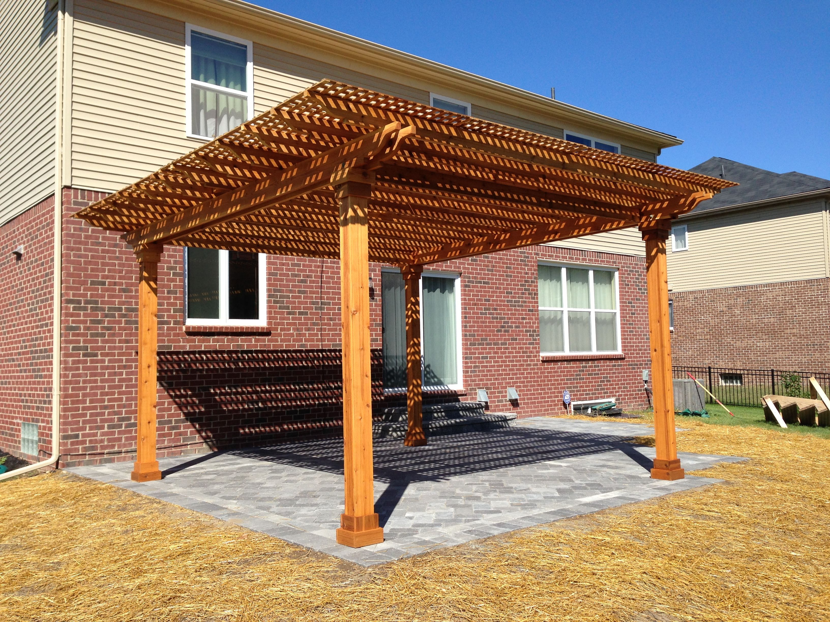 12x12 Cedar Pergola With Lattice Top Over A Unilock Patio