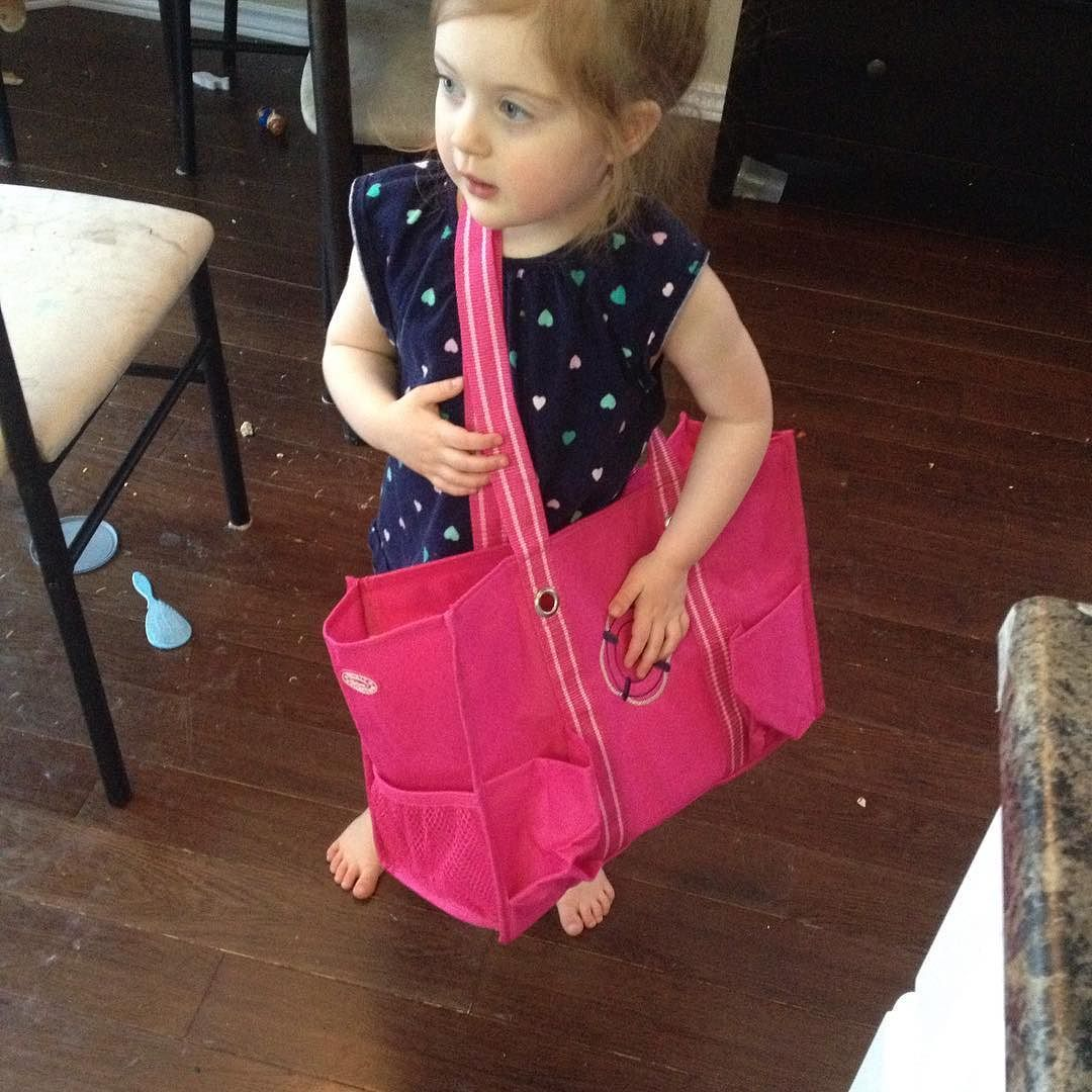 She is LOVING the new #spiritpink #ziptoporganizingutilitytote from #thirtyone.  I haven't used it once she always has it full of toys by raisingfairiesandknights