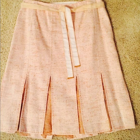 Ellie Tahari Skirt Beautiful orange and cream skirt. This skirt is fitted with a flare just above-the-knee. It has a silk pleat feature. Very stylish. Barely worn. Elie Tahari Skirts