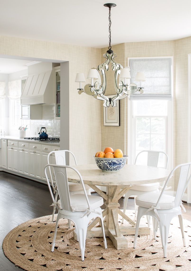 Round Kitchen Table Setting With White Rustic Chairs And Round