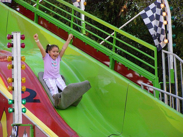 Girl on carnival slide having fun by amboo who?, via Flickr