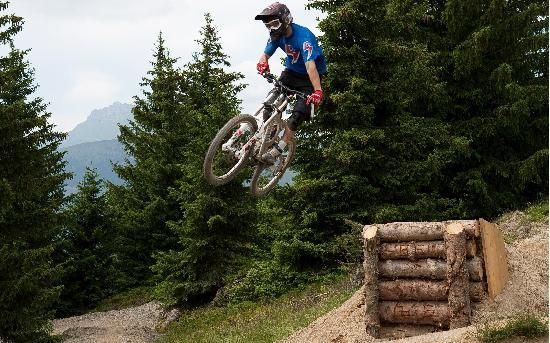 Using Logs To Build A Jump On A Mountainbike Trail Track Bike