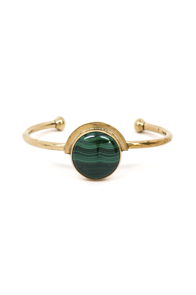 Add some shine to your outfit with this beautiful cuff.