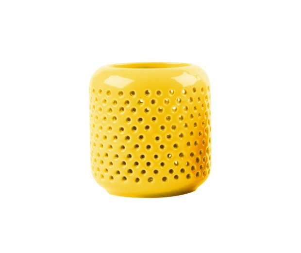 Yellow Tea Light Holder. Accessorize your home with this vibrant, bright, yellow tea light holder. Made of ceramic, it features a grid pattern that projects when illuminated by candlelight.