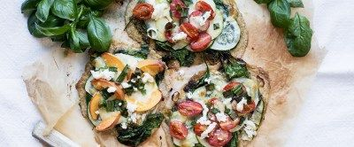Summer Pizzas w/ pesto, greens, zucchini, peach, tomatoes & mozzarella