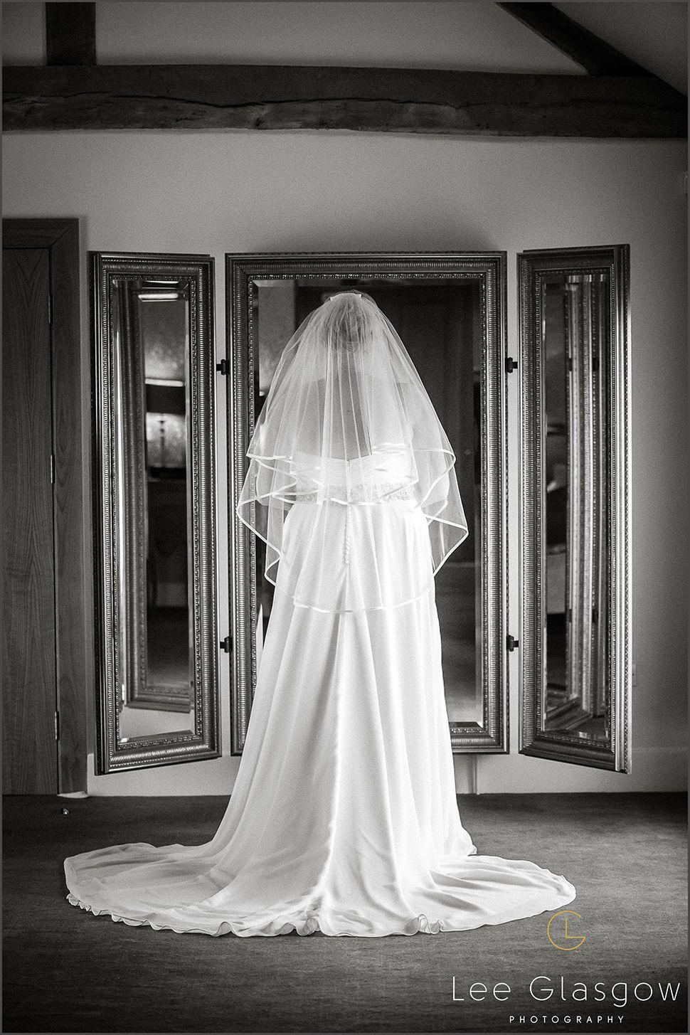 Bride at Mythe Barn Wedding venue.   Wedding, Barn wedding ...