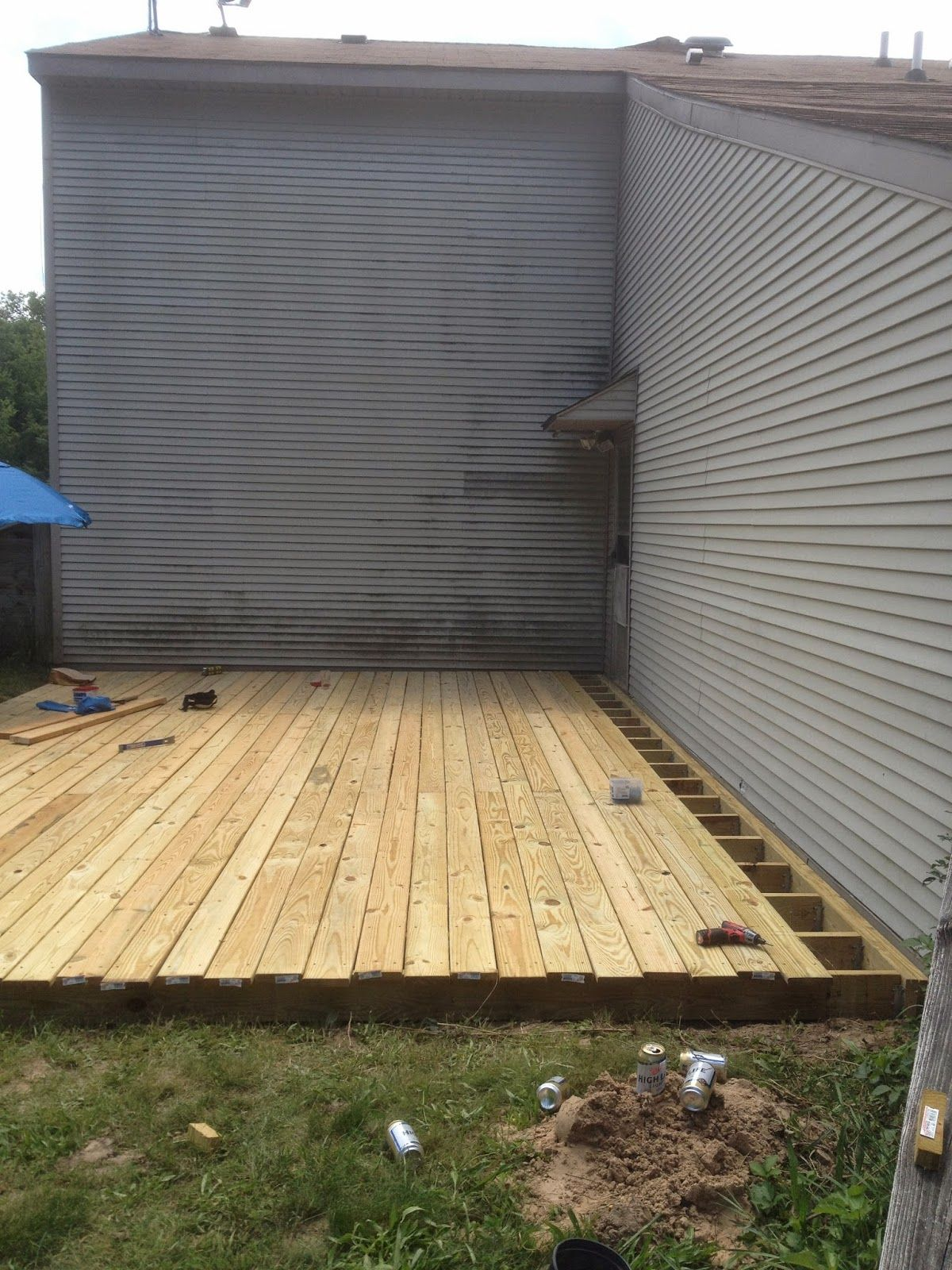 Attaching deck to house with siding - From Dirt To Deck How To Build A Ground Level Deck The Wolven