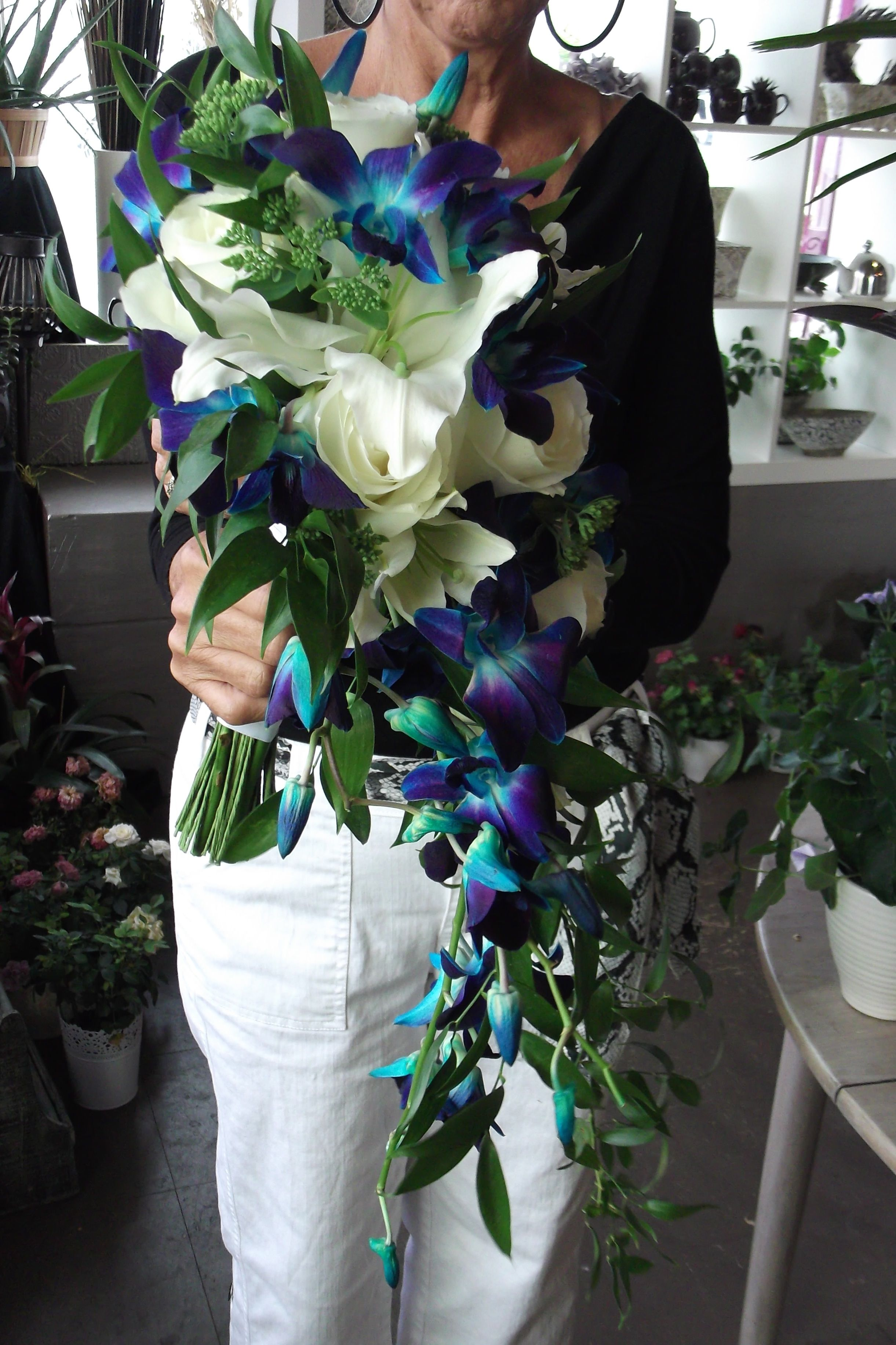White casablanca lily and blue dendrobium orchid hand tied