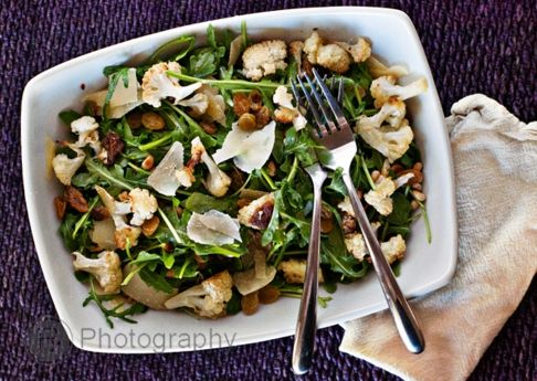 Arugula Salad with Roasted Cauliflower, Golden Raisins, Parmesan, and Toasted Pine Nuts with a LemonVinaigrette
