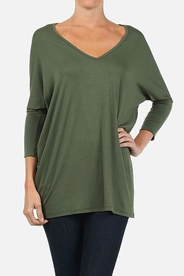 Loose fitted v-neck top with 3/4 length dolman sleeves and hi-low hem by Freeloader. Shop now at cinnaryn.com.