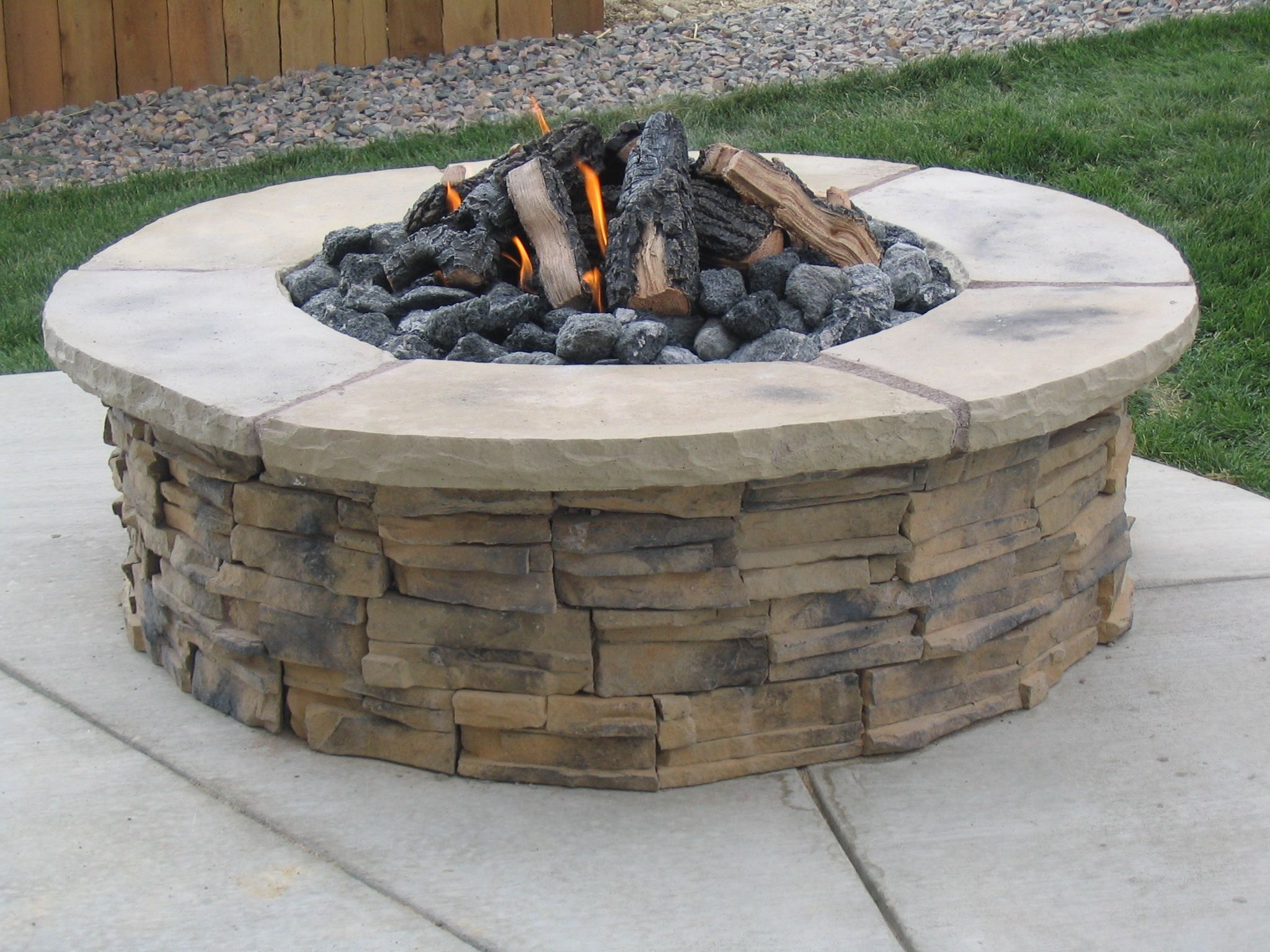 traditional outdoor heater design ideas with pavestone fire pit