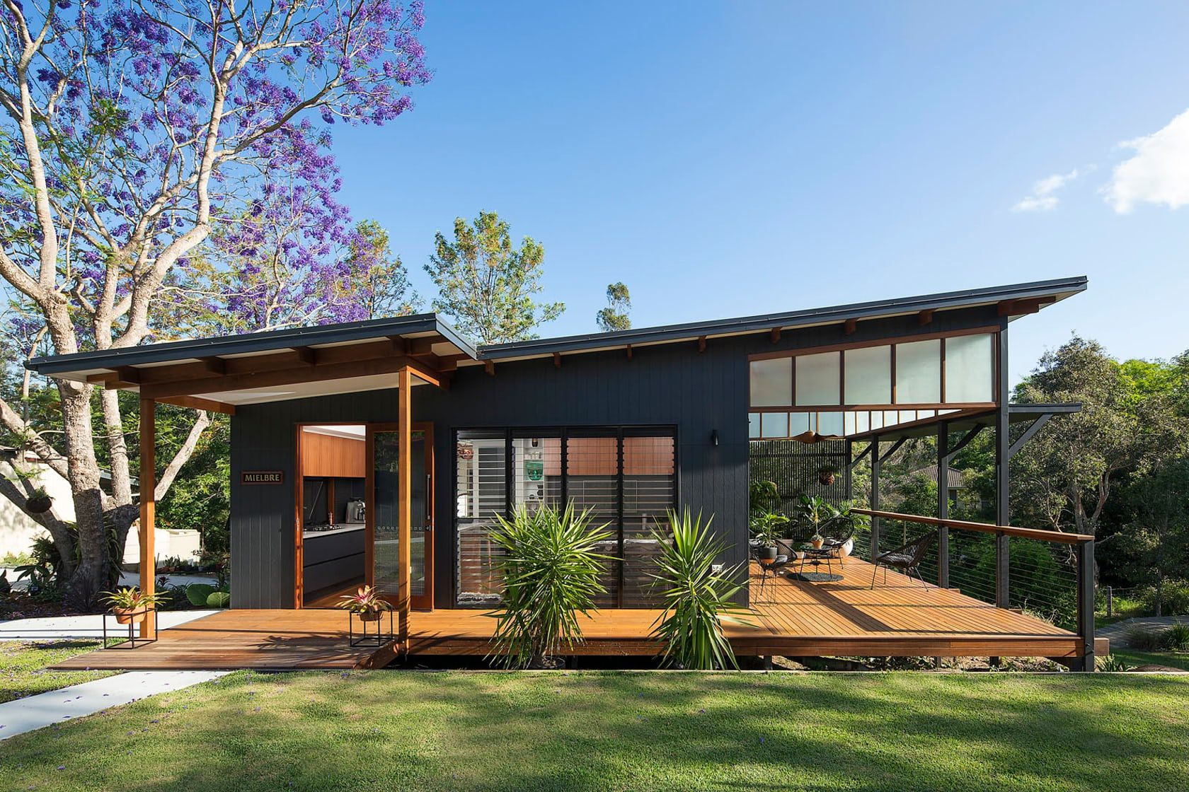 This modern tropical home is a granny flat for a hip for Skillion roof definition