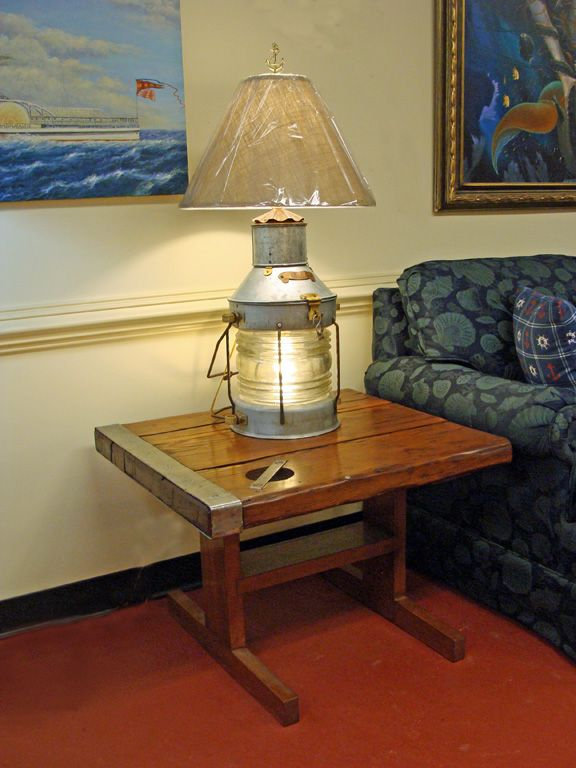 A Re Purposed Large Anchor Lantern Table Lamp Lights Up The Top Of A  Nautical