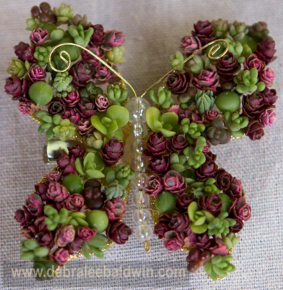 This is incredible. It's a hair clip with glued string of pearls and sedum rosettes. This wonderful creation is by Laura Eubanks.