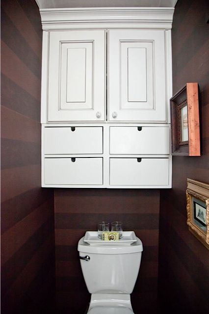 Cabinet above toilet, horizontal striped wallpaper | Baño | Bathroom, Bathroom cabinets ...