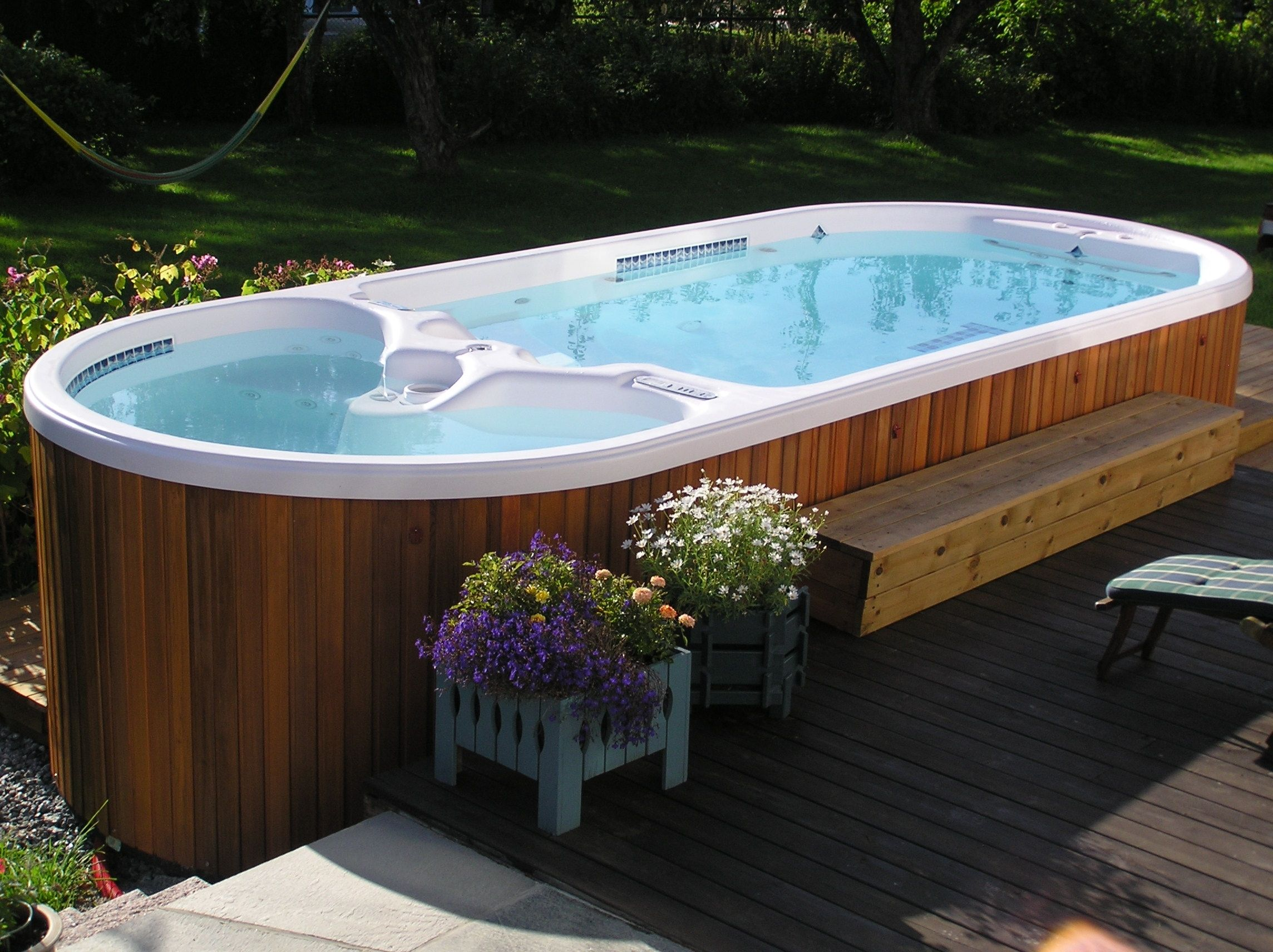 A Swim Spa And Hot Tub In One Yes Please Hot Tub Backyard Outdoor Spas Hot Tubs Hot Tub Landscaping