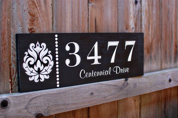 Wooden Address Sign Maybe Mounted On The House Or Another