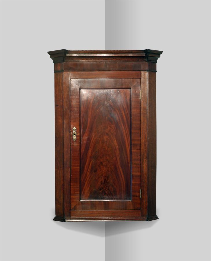 Corner Cupboard - 19th century mahogany corner cupboard. Moulded cornice  over a crossbanded frieze and figured panel door. The interior fitted with  shaped ... - Antique Corner Cupboard Interior Details & Accents Pinterest
