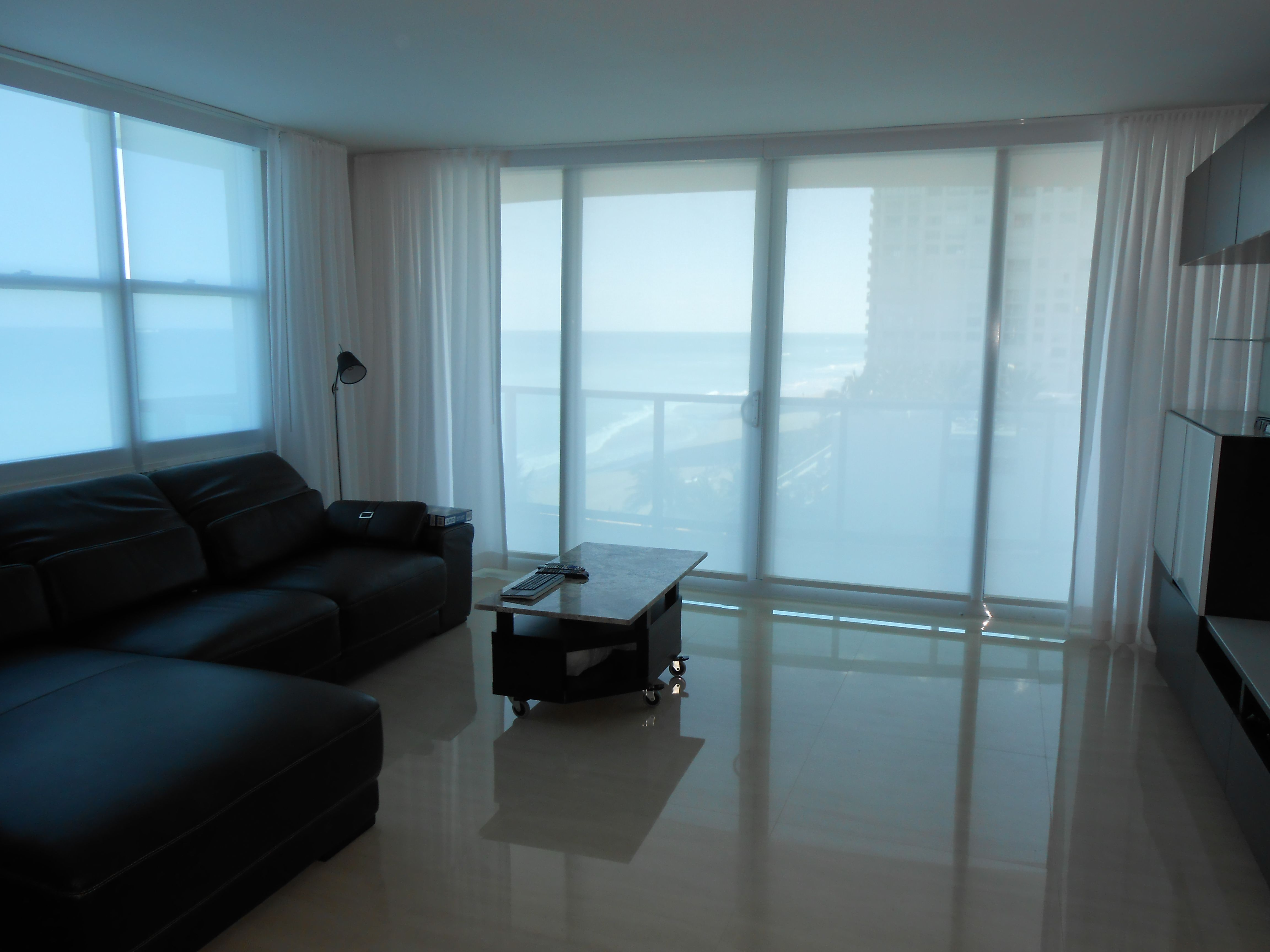 Sheer Roller Shades And Pinch Pleat Curtains Installed In A Miami