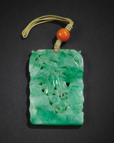 A mottled green and white Jadeite Pendant, Qing Dynasty, 19th century
