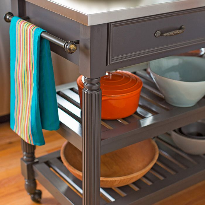 This compact ready-made kitchen island features a designer ...