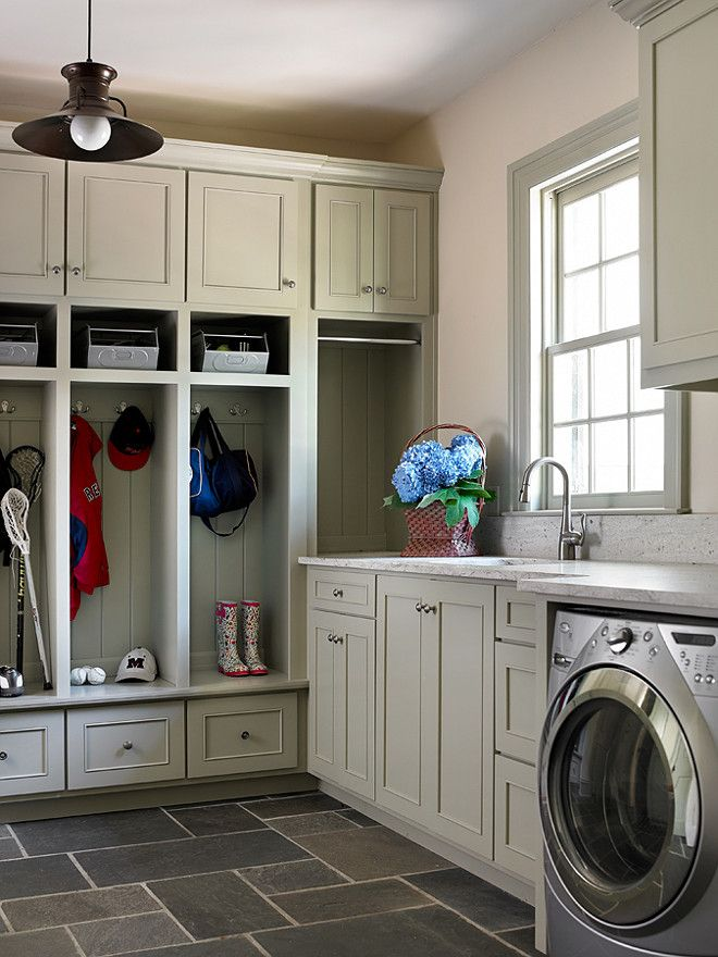 Mudroom And Laundry Room Combined In Featuring Gray Open Locker Cabinets Filled With Metal Baskets Over Slate Tiled Floor