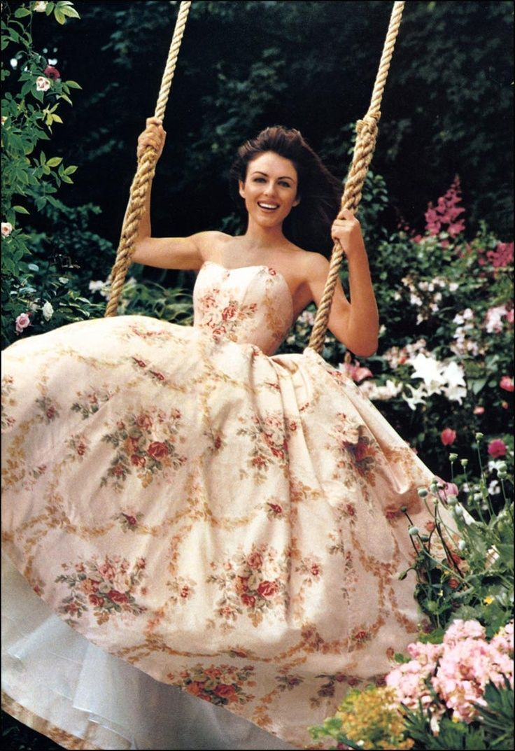 Swinging in a beautiful Rose patterned gown