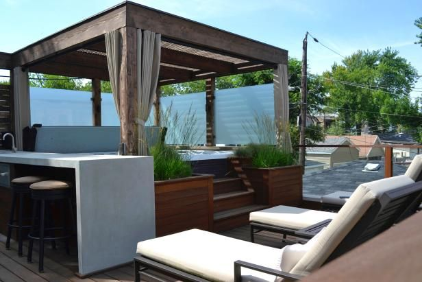 hot tub retreat with pergola outdoor seating and bar area patio