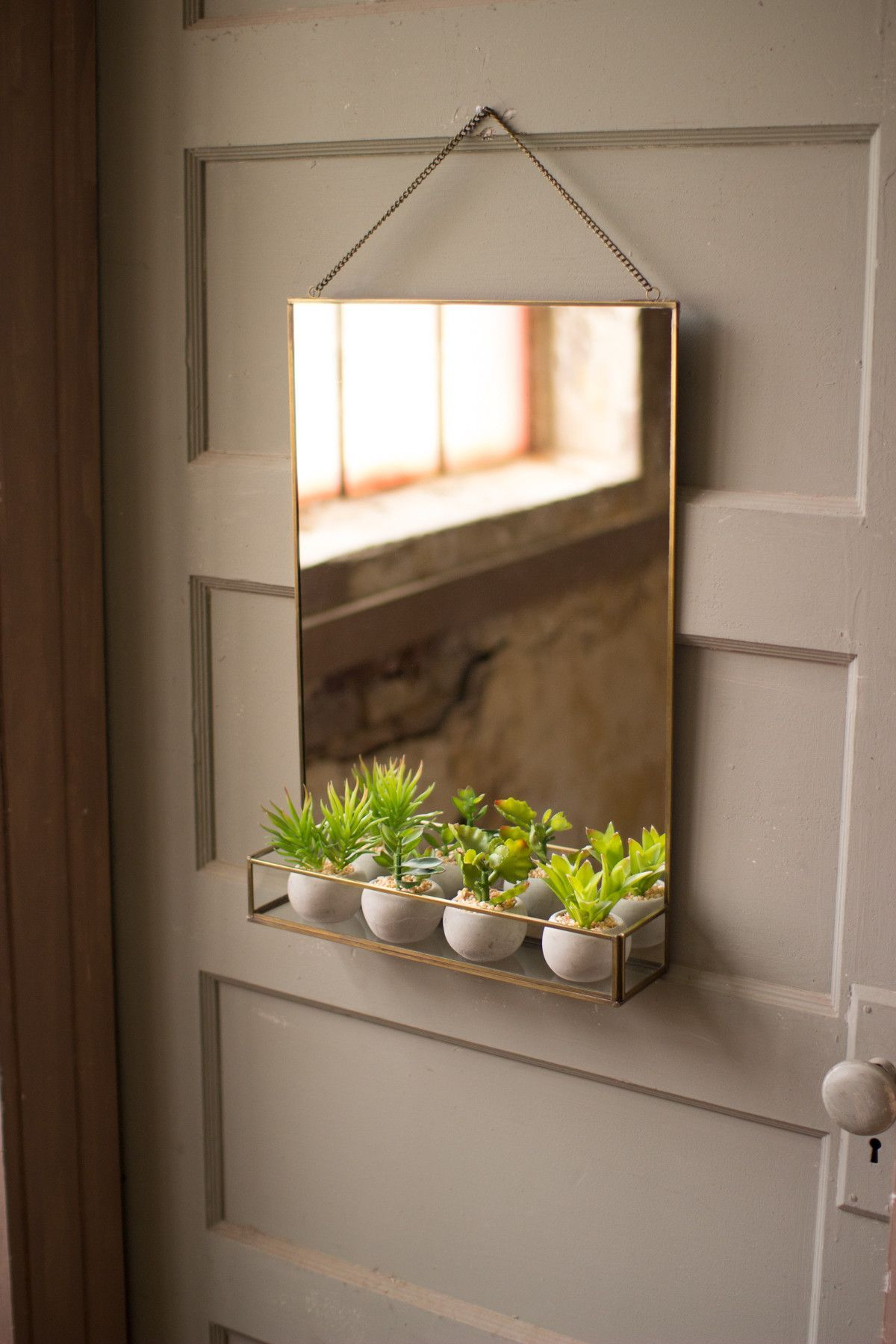 Coated with a brass finish and equipped with a chain hanger this so fun and dual purposed mirror with metal trim and planter from the painted fox amipublicfo Image collections