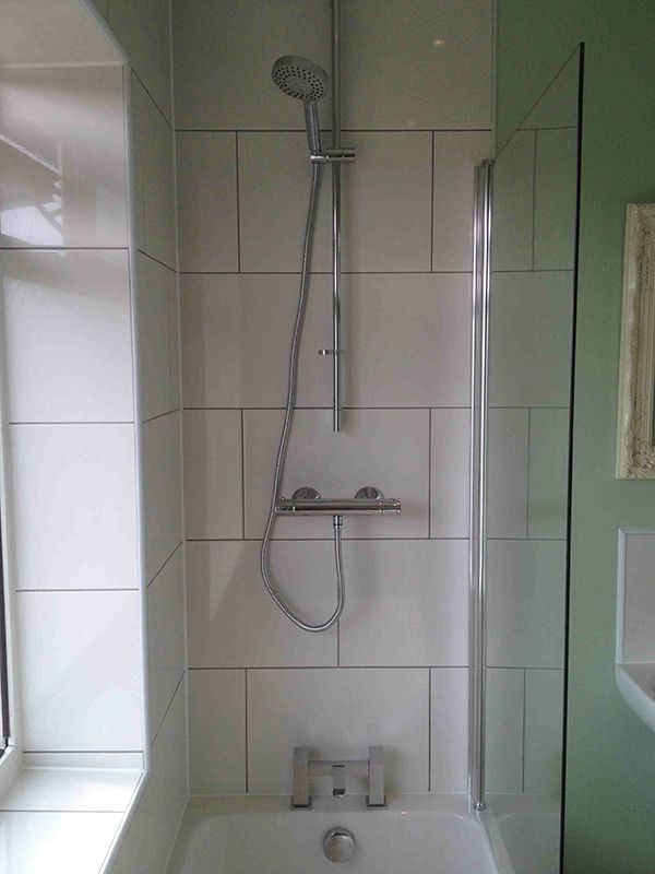 Grey grout with white brick pattern tiles with bathroom for Bathroom design leeds