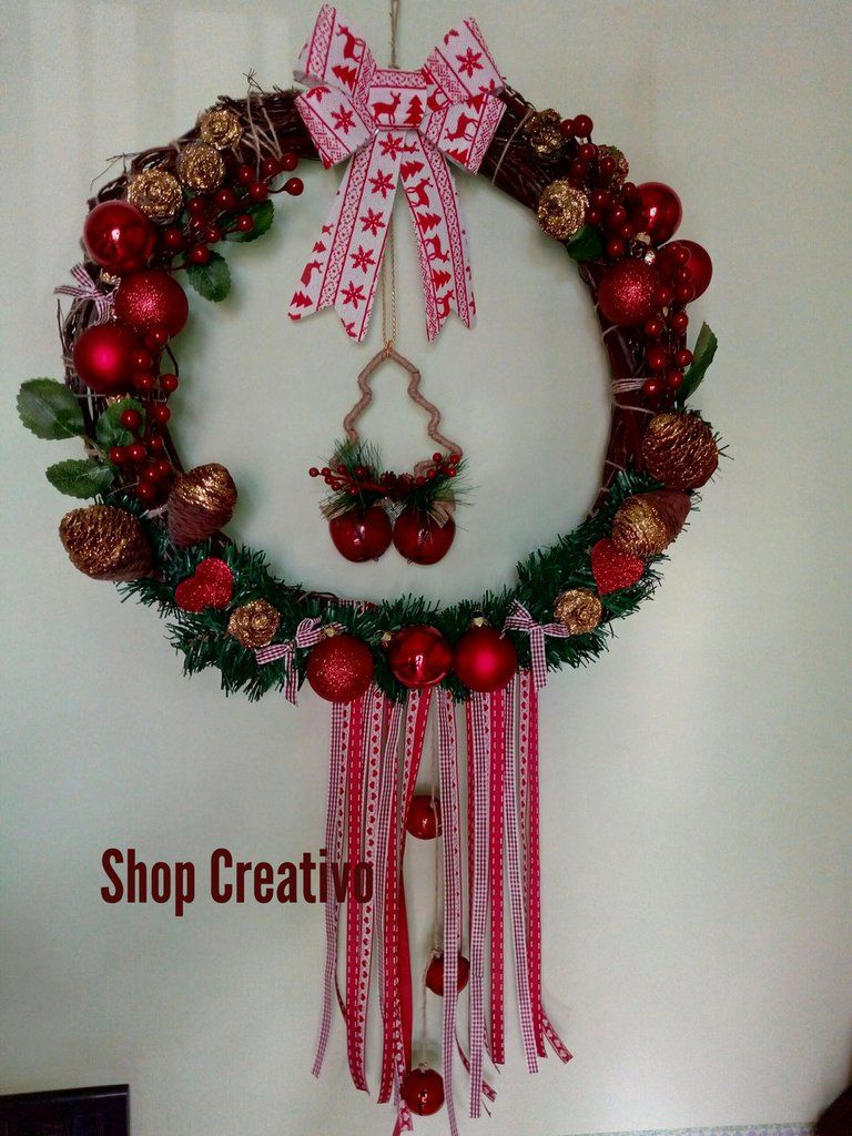 Photo of Christmas out door in wooden wreath with intertwined branches