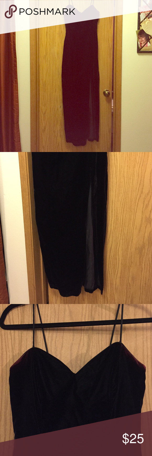 Full length black velvet dress Formal full length black velvet dress w/ side slit. It has spaghetti straps & back zipper closure. A little discoloration in the under arm area, looks dark red but not noticeable when being worn. It's still in good shape. LA Glo Dresses Prom