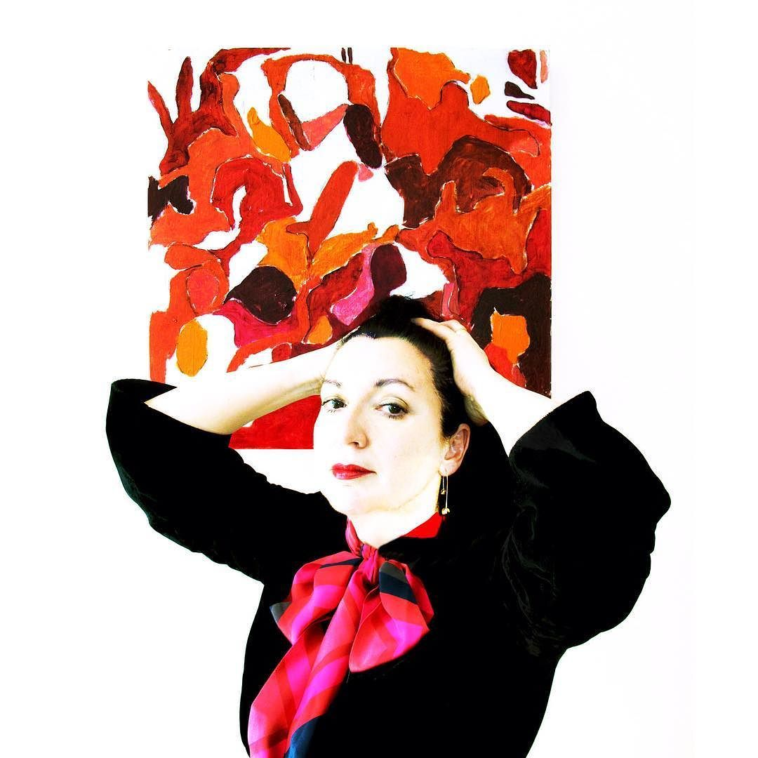 Conchita Lucas wearing  Skinny Link scarf as a pussy-bow.  Abstract painting .  her new work in progress  #scarf #scarves #prints #painting #abstract