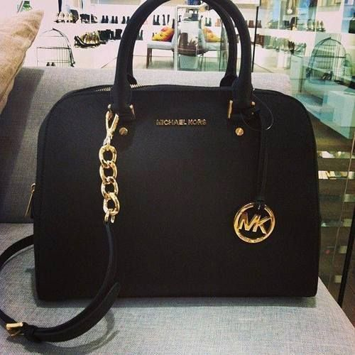 b523c4132452 bags michael kors MK black. Black and gold bag I've wanted for so long, if  a girls going to collect something, it might as we'll be Michael Kors bags.