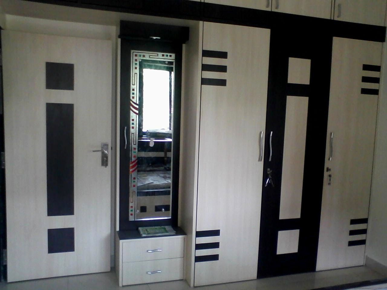 Design wardrobes for bedroom wardrobe design for bedroom for Cupboard door design ideas