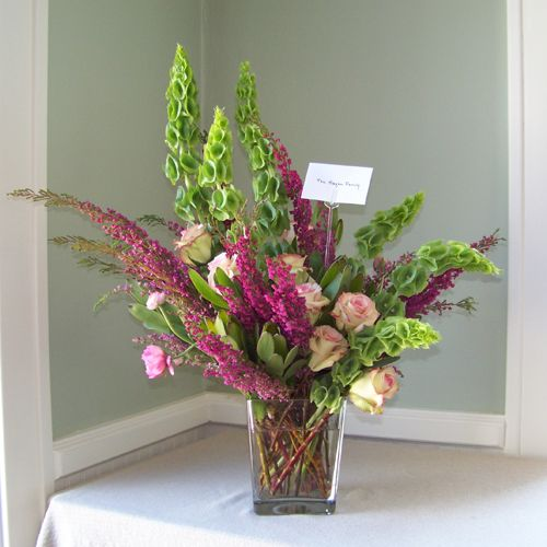 Sympathy Arrangement With Bells Of Ireland Green Leucadendron Cezanne Roses Pink Ranunculus And H Flower Arrangements Floral Arrangements Modern Wedding Diy