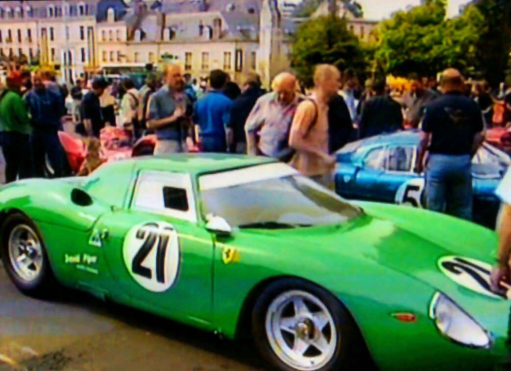 A green Ferrari at an historical race supporting the Le