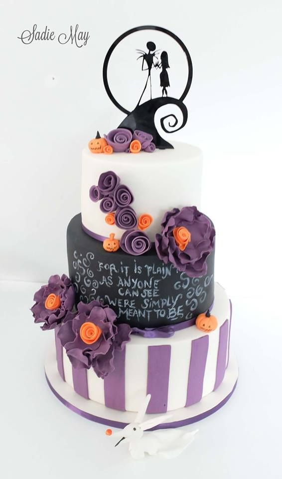 the nightmare before christmas wedding cake in black purple orange and white icing made by sadie may cakes httpwwwweddingheartcouksadie may cakes