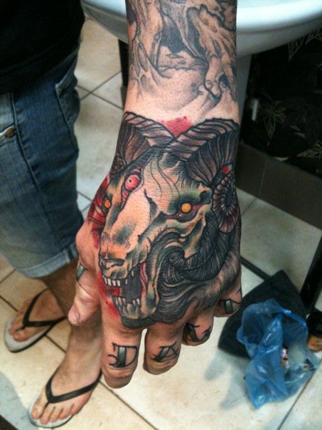 Matt D. Mooney – gnarly ram skull tattoo