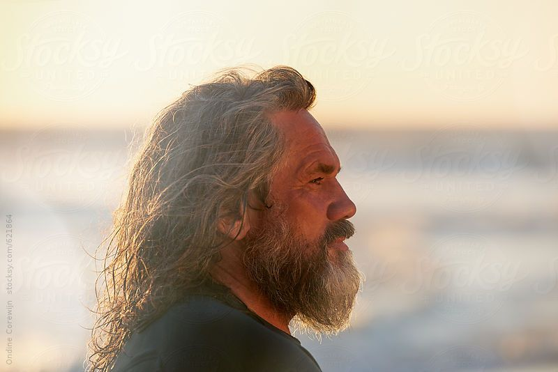 Profile Portrait Of Old Surfer At Sunset On The Beach With Beard Surfer Portrait Sunset