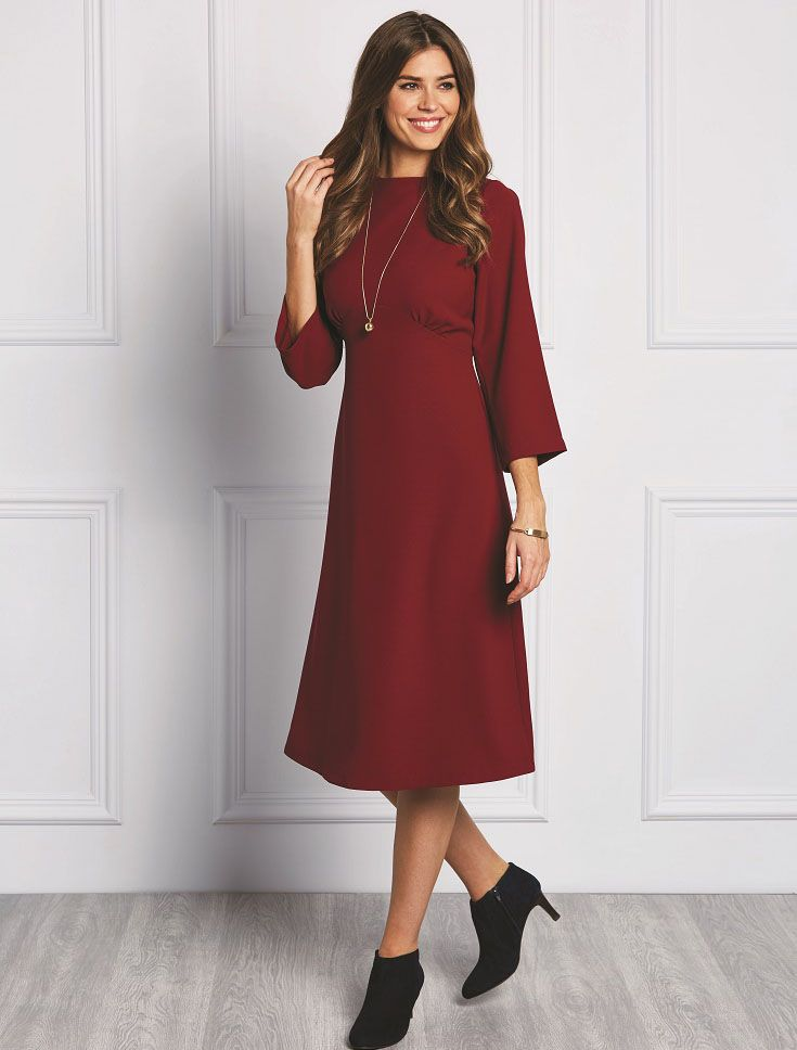 Marjorie is a sleek and sophisticated long-sleeved empire dress made ...