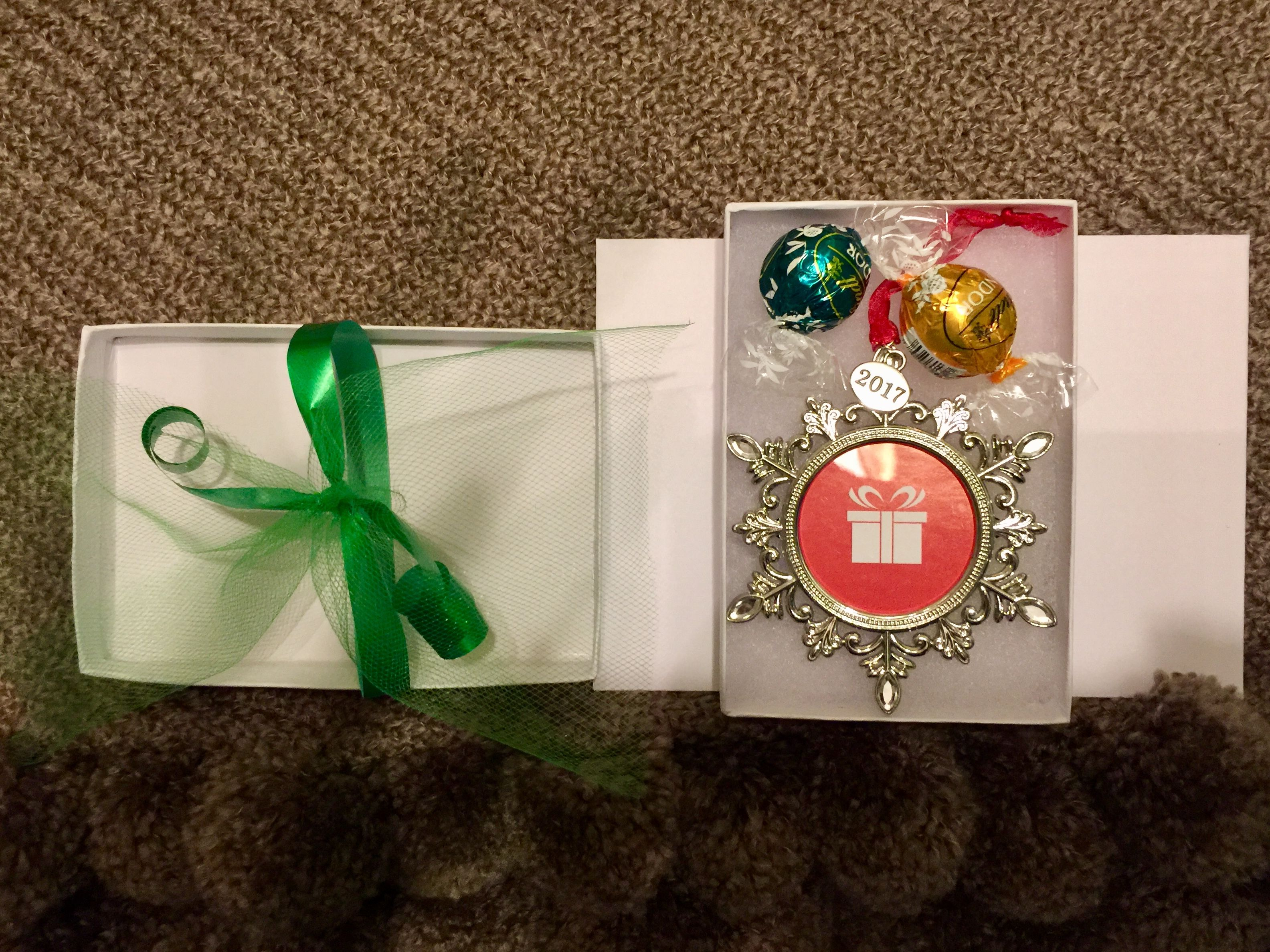 Christmas Gift Idea Ornament And Pieces Of Chocolate Candy Inside