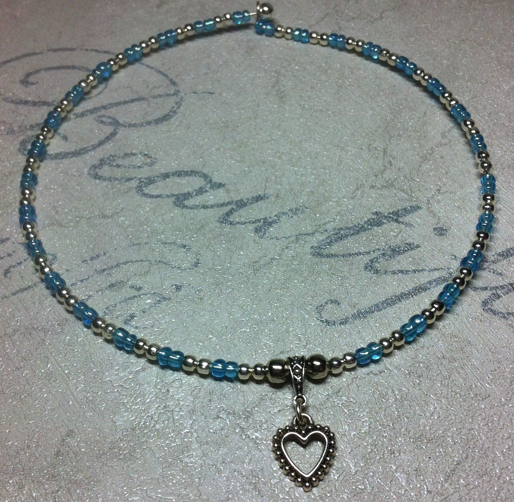 Handmade blue and pearl seed beads on wire choker with hollow heart charm