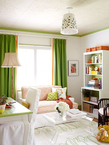 This small spare room serves a big-time role as home office and guest room. To keep the room from feeling cluttered, the designer chose appropriate-size furniture, simple accessories, and smart storage units. A soft color palette and white painted walls reflect light and make the room seem larger. A love seat provides a comfy spot to read and converts into a twin bed when guests pay a visit.
