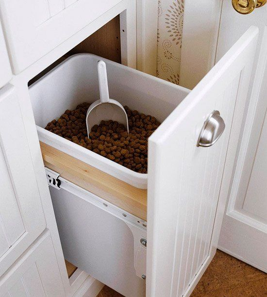 You love your pets — there's no question about that. But sometimes their stuff can be hard to incorporate into your space. When it comes to food and water bowls, beds, crates, and even kibble storage there are plenty of ways to seamlessly make your furry friends part of your home — including the kitchen. Here are eight genius ways to organize your pet supplies in your kitchen.