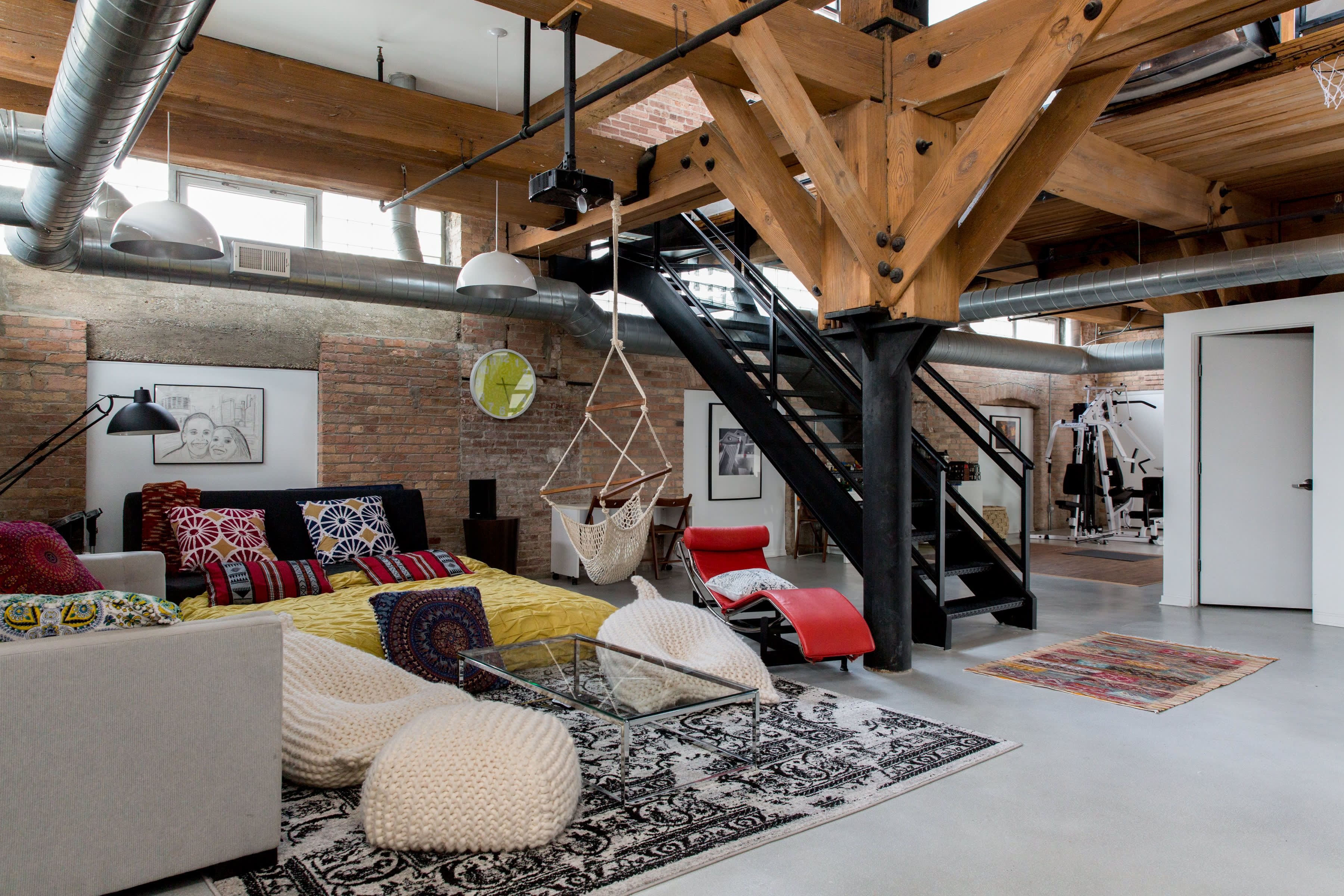 A Cozy Warm Industrial Remodeled Chicago Loft Warm Industrial Black Living Room Living Room Photos #warm #industrial #living #room