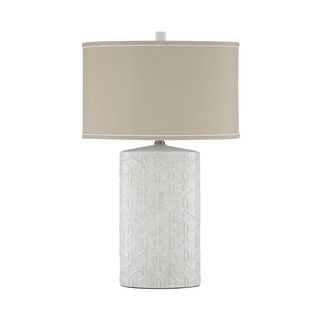 This understatedly chic ceramic lamp sports a richly texural base ...